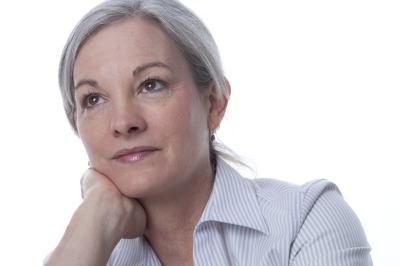 grey haired woman thinking